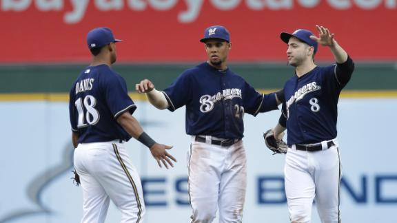 Herrera has 5 hits as Brewers snap skid at 7