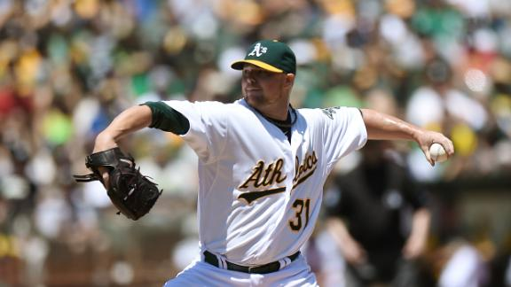 Lester Wins Debut With A's