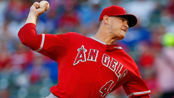 Richards wins 13th as Angels hold off Texas