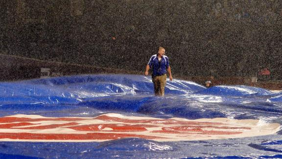 Tarp troubles lead to long delay, shortened game