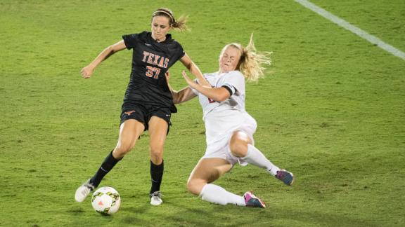 Longhorns Tie Razorbacks in Home Opener