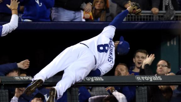 Video - Moustakas' Acrobatic Grab Lands Him In Stands