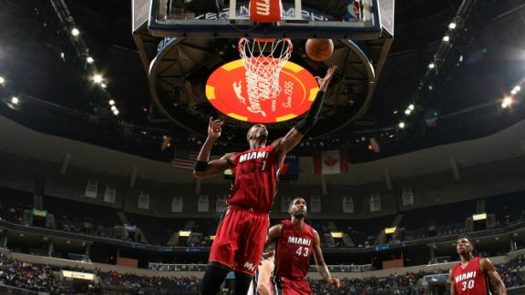 Wade, Bosh Lead Heat To Win