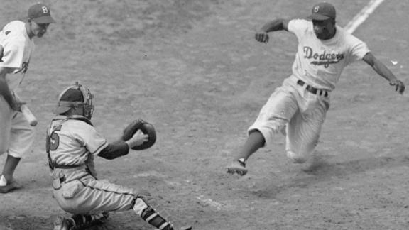 http://a.espncdn.com/media/motion/2015/0415/dm_150415_mlb_jackie_robinson_sand_feature/dm_150415_mlb_jackie_robinson_sand_feature.jpg