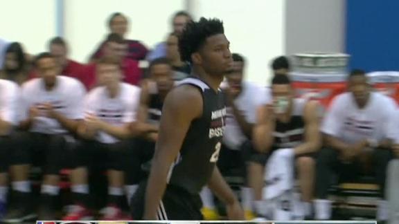 Winslow leads Heat in debut