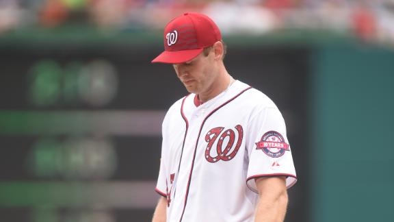 Nats' Strasburg exits early with tightness in side