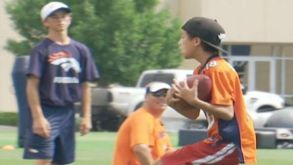 Manning throws football routes to kids