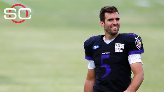 Flacco gets Special Olympics medal from fan