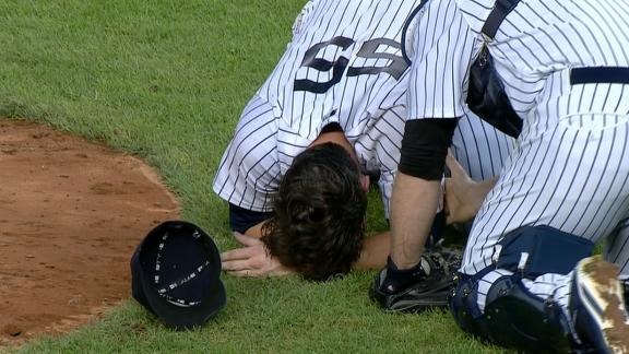 Yankees pitcher Mitchell hit in face