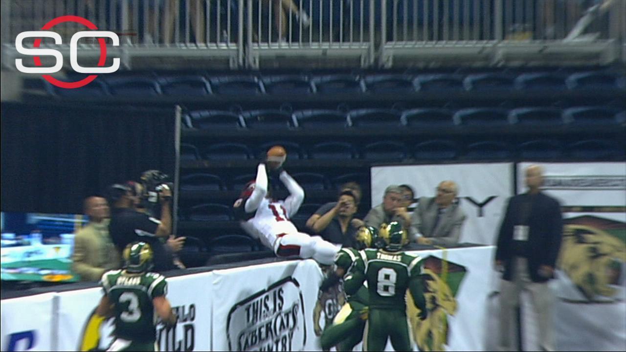 Arena football player makes acrobatic grab