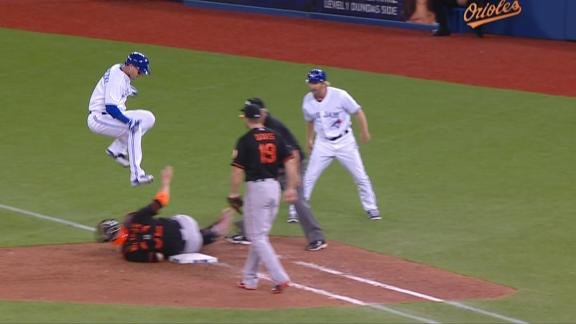 Tulowitzki leaps over Wieters, dodges tag