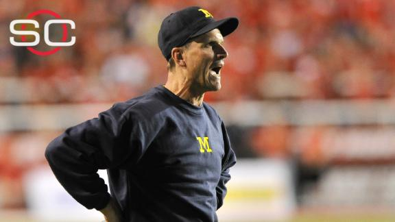 Harbaugh loses in Michigan debut