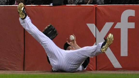 Shuck bobbles ball, completes catch on his back