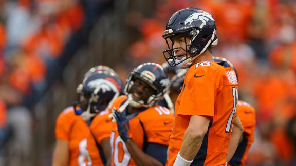 Manning hits milestone before getting benched
