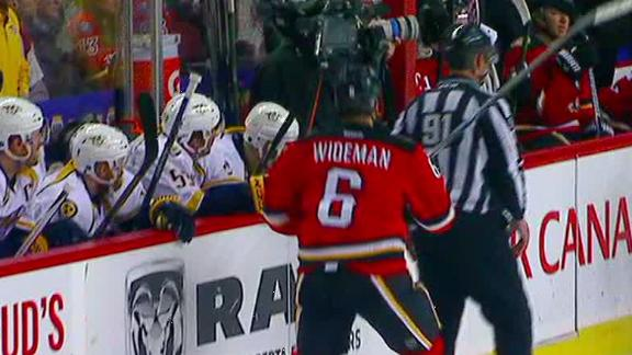 Flames' Wideman knocks down official