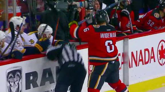 Flames' Dennis Wideman collides with official