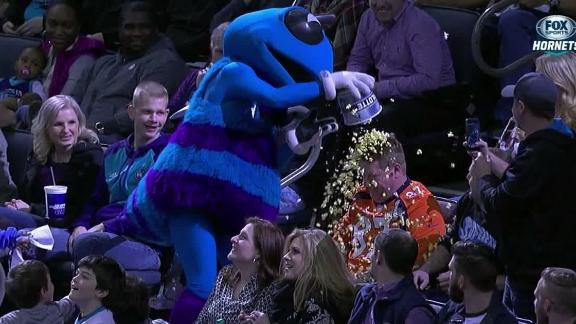 Broncos fan gets popcorn shower from Hornets mascot