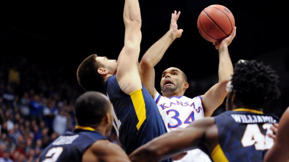Kansas tops WVU to keep pace in Big 12 race