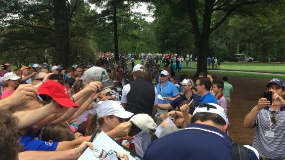 Huge crowd to see Kuechly caddy for Olsen