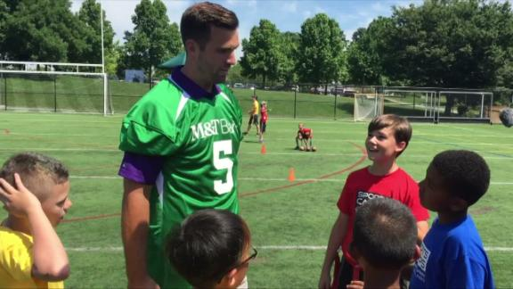 Video - Flacco surprises kids at football camp