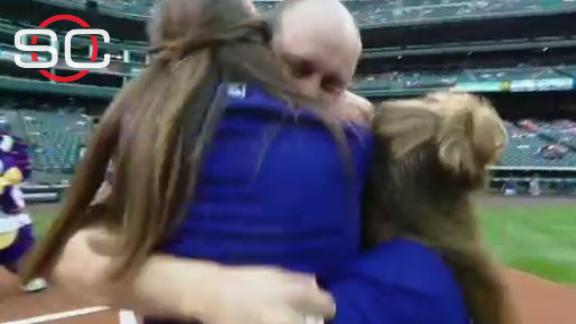 Father surprises daughters with first pitch