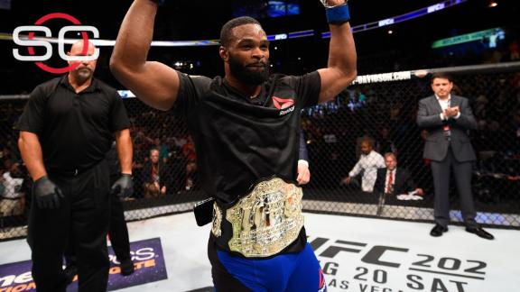 Woodley stuns Lawler to take welterweight title