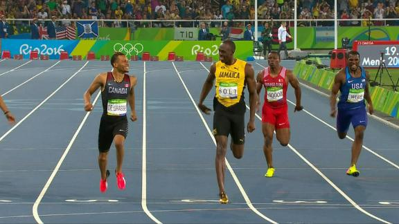 WATCH: Bolt toys with De Grasse in 200m semifinal