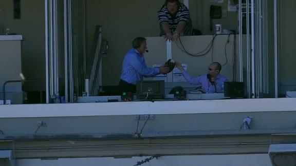 Royals announcer ready with glove and all