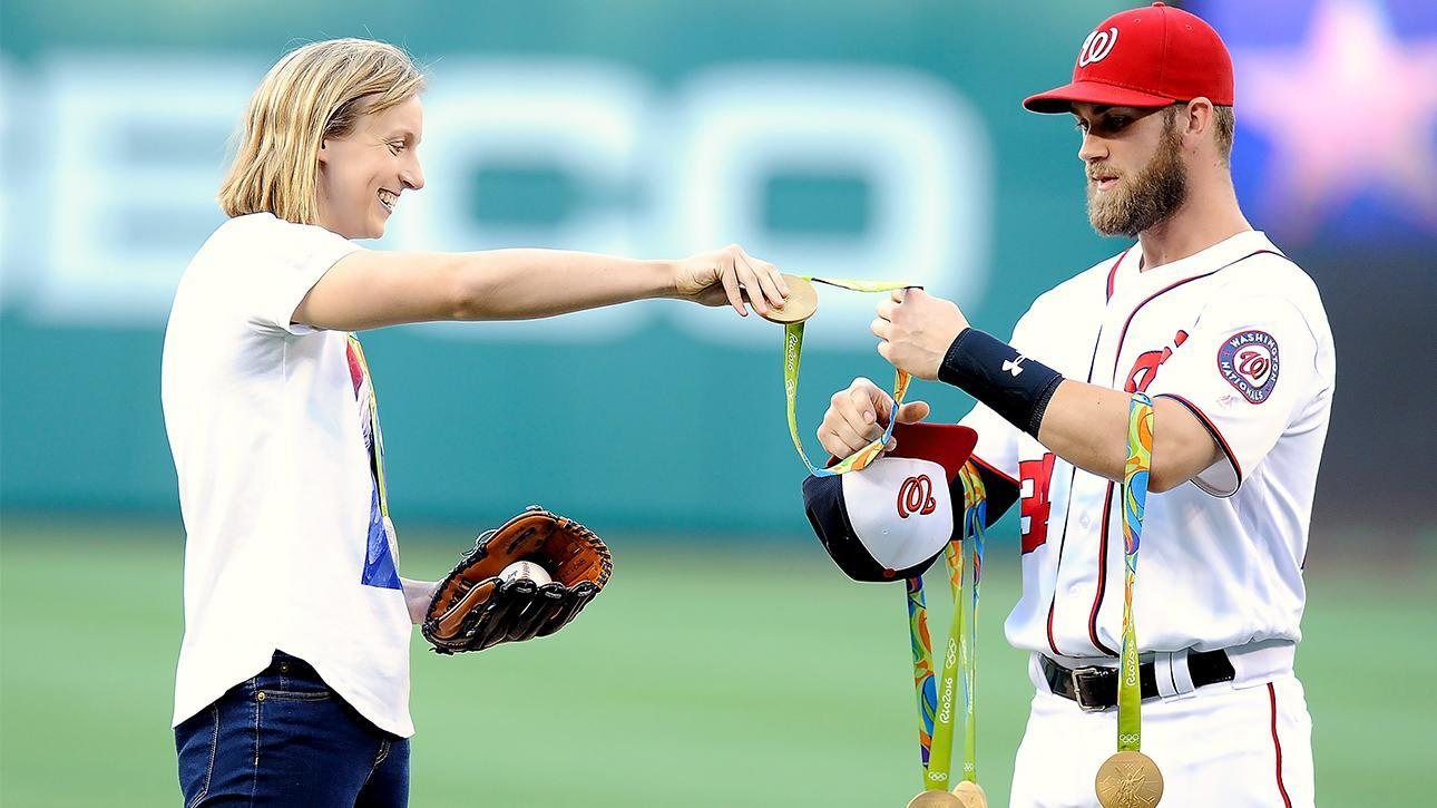 Ledecky throws first pitch as Harper holds her medals