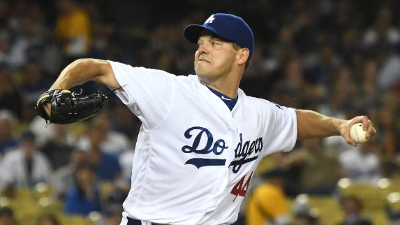 Hill solid in debut as Dodgers blank Giants