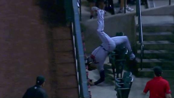 Freeman takes scary fall into stands