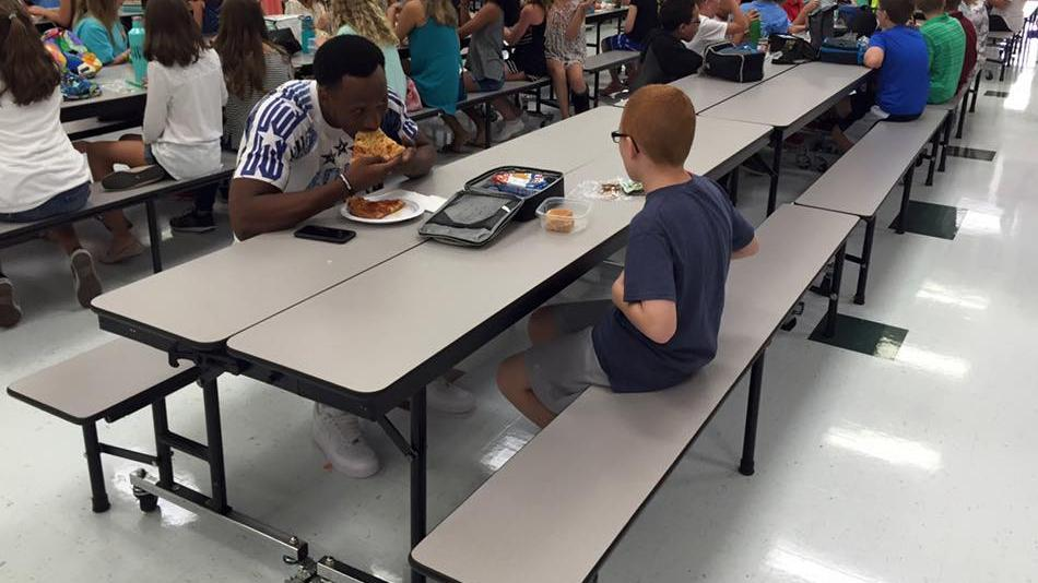 Rudolph eats lunch with student with autism