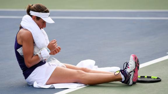 Konta returns to win match after collapsing on court
