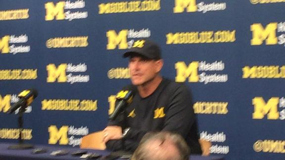 Michigan's Jim Harbaugh supports players' raising fists during anthem