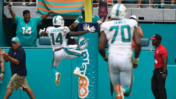 Landry celebrates 42-yard TD catch by hugging the goal post