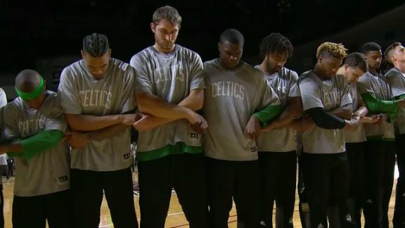 Celtics link arms during national anthem