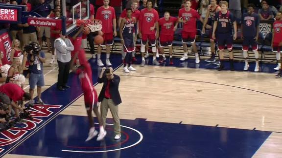 Arizona's Alkins slams ferocious dunk with help from coach