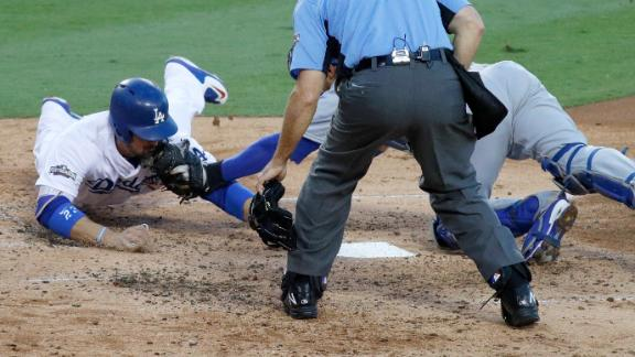 Gonzalez called out on close play at plate