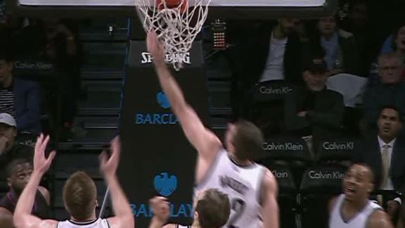 Joe Harris tips in buzzer beater