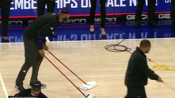 Cousins mops up wet floor