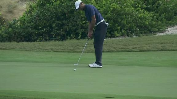 Woods fires 65, almost aces No. 12