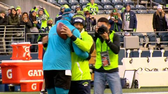 Newton, Wilson hug it out pregame