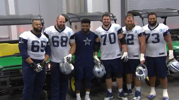 Elliott gives the gift of a John Deere to O-line