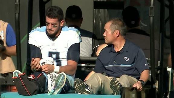 Mariota carted off with fractured fibula