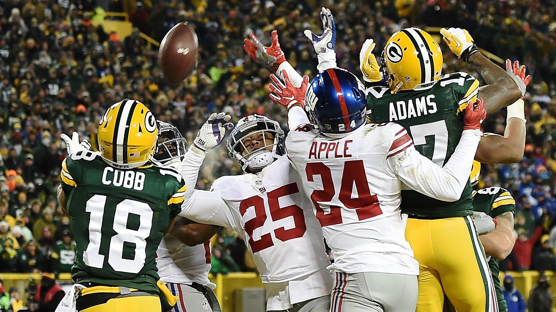 Packers' victory comes with Hail Mary to end first half