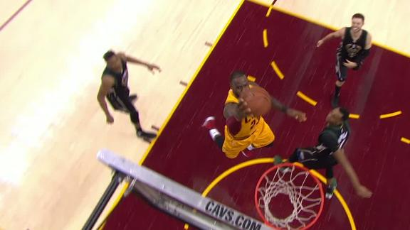 LeBron flies by Dellavedova for dunk and the foul