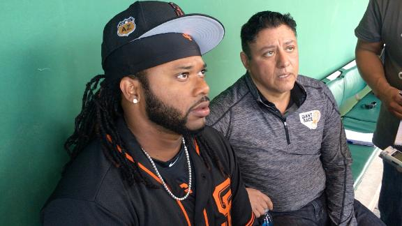 Cueto back at camp after death of father