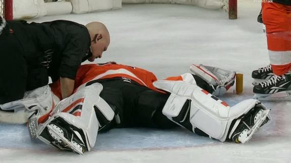 Flyers goalie Neuvirth collapses on the ice