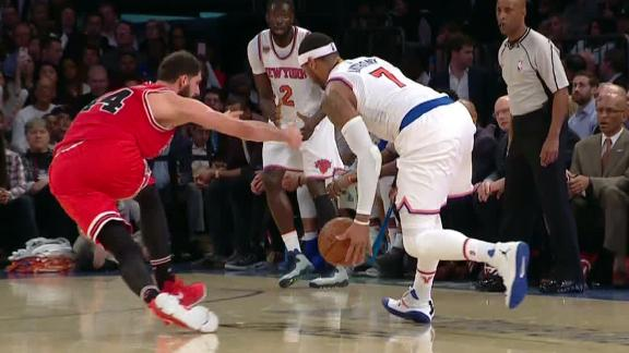 Melo trips up defender for 3