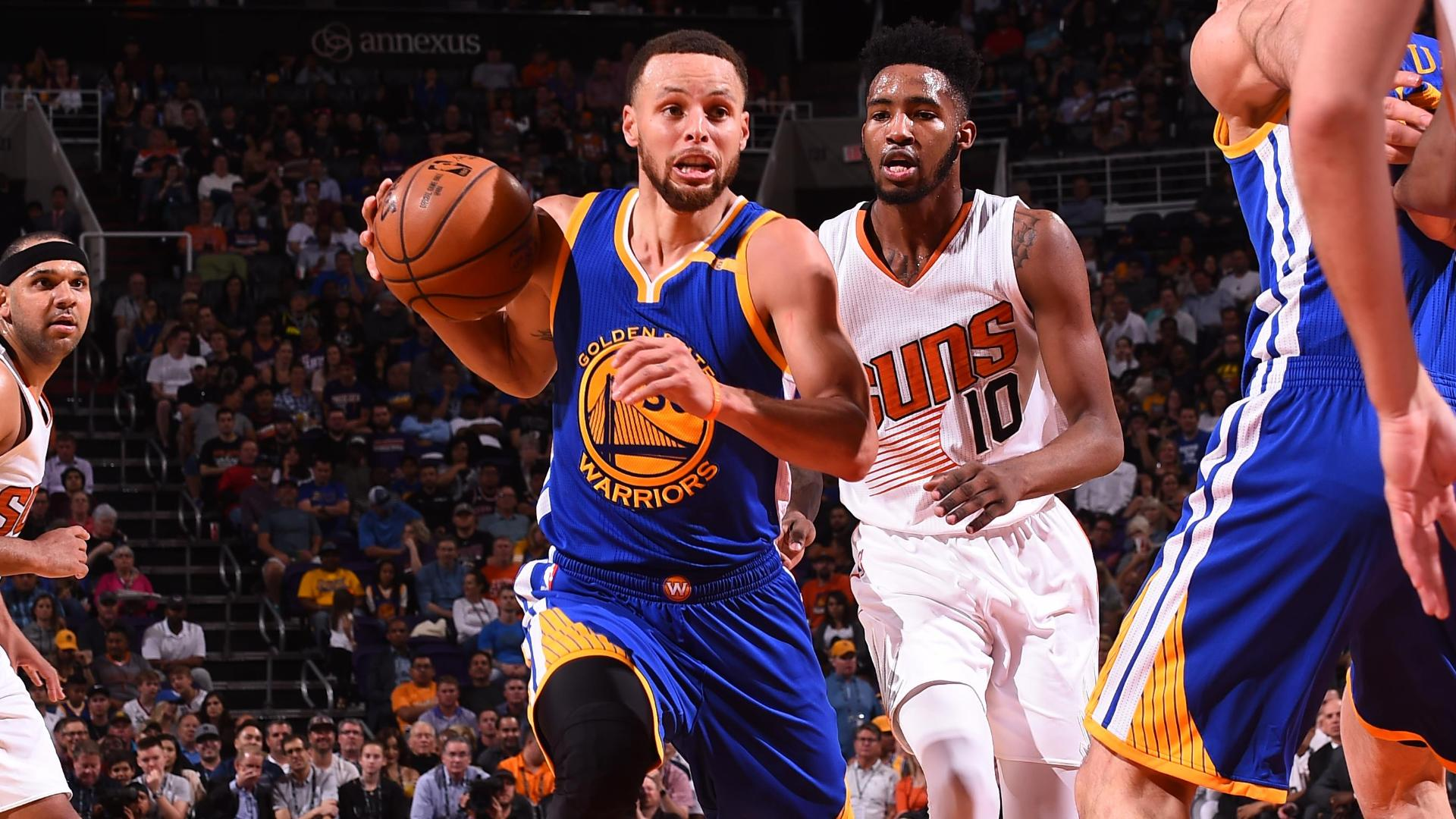 Curry puts on a show as Warriors beat Suns